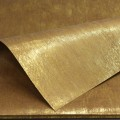 Non-Woven Bronzing Wrap.  Color: #15 - Gold.  Size:  80cm x 60cm.  Pack in 20's per polybag.  Available in 6 Colors